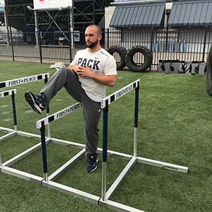 athelte training with hurdles