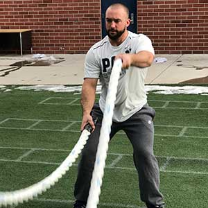 athelete training with ropes